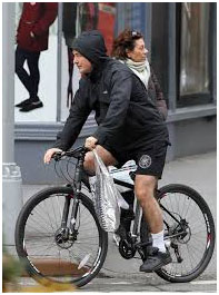 Alec Baldwin riding his bike