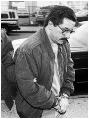 Anthony Casso in hand cuffs