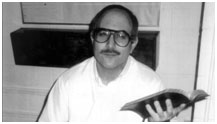 David Berkowitz holding a bible in jail