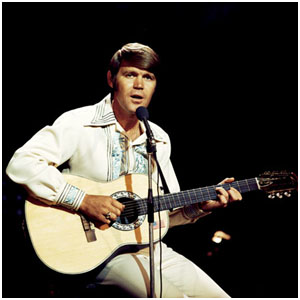 Glen Campbell playing guitar