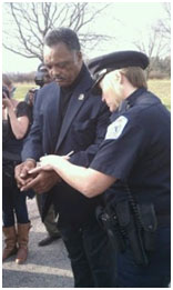 Jesse Jackson while getting arrested