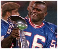Lawrence Taylor holding the superbowl trophy