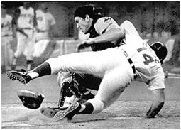 Pete Rose crashing into Ray Fosse