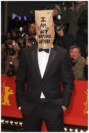 Shia LaBeouf with a paper bag over his head