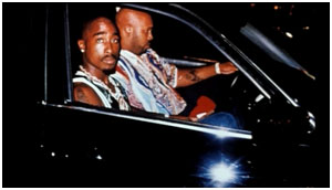 Suge Knight in car with Tupac